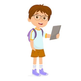 School boy giocando a tablet