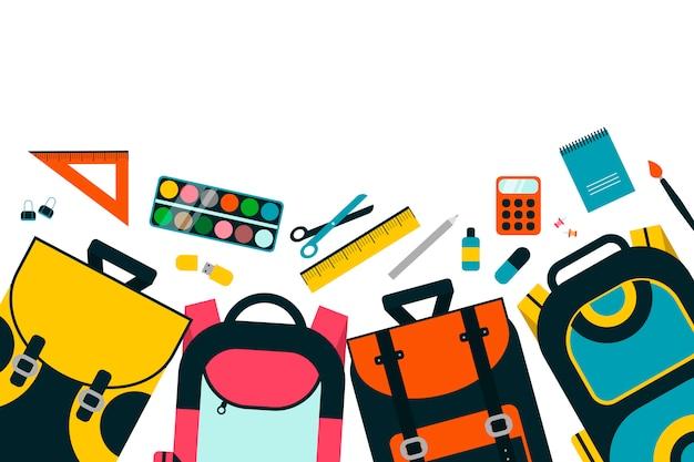 Schoolbags variopinti dei bambini su priorità bassa bianca.