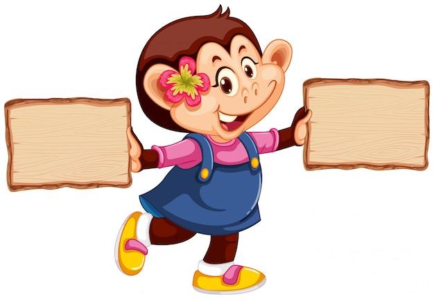 Scimmia con cartello in legno