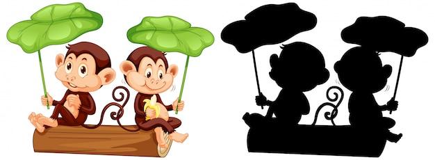 Scimmie che tengono foglia con la sua siluetta