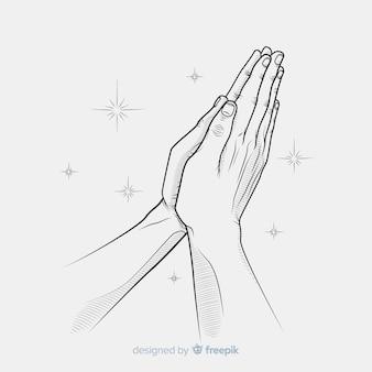 Scintille che pregano le mani sullo sfondo