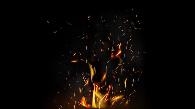 Scintille di fuoco su uno sfondo nero