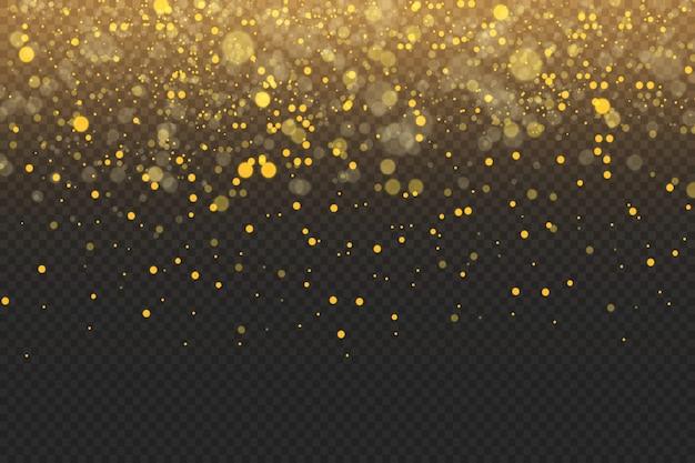Scintille dorate e stelle dorate brillano con uno speciale effetto di luce