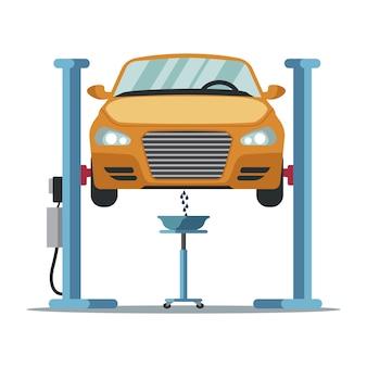 Scolare il vecchio antigelo. sostituzione del liquido di raffreddamento. cambio dell'olio in auto. stazione di servizio. servizio auto