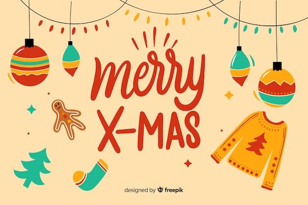 Scritte in merry christmas con palline e maglione