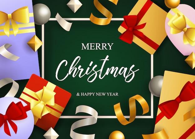 Scritte in merry christmas, scatole regalo con fiocchi in nastro