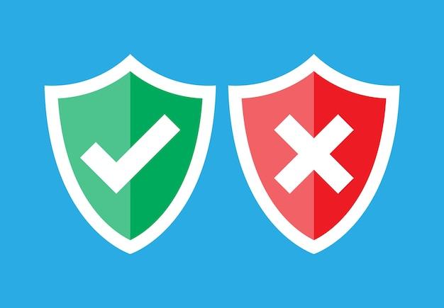 Scudi e segni di spunta. approvato e rifiutato. scudo rosso e verde con segno di spunta e segno x.