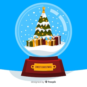 Scuotendo il globo con albero di natale e regali