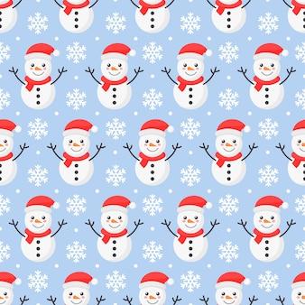 Seamless pattern di natale. pupazzo di neve isolato sul blu