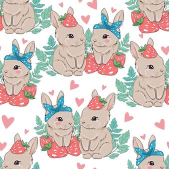 Seamless pattern simpatico coniglietto con fragole su uno sfondo bianco.