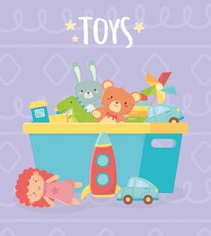 Secchio blu con molti giocattoli divertenti