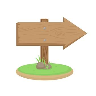 Segnale di direzione in legno con erba verde e rocce