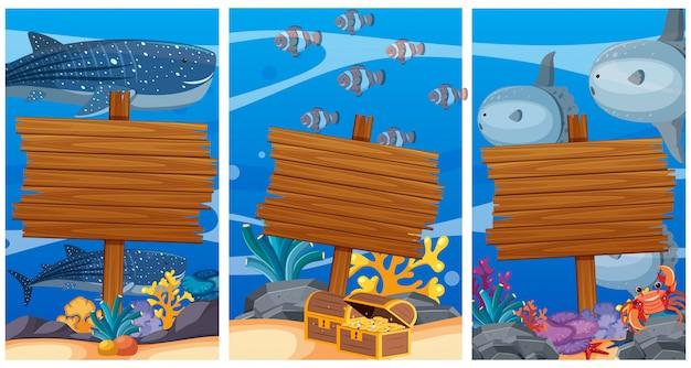 Segni di legno sotto l'oceano con animali marini in background
