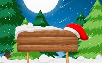 Segno di legno con scena di cappello di Babbo Natale