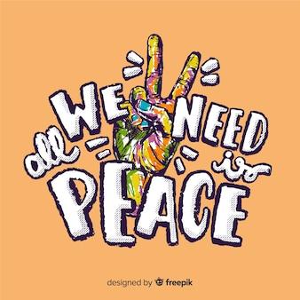 Segno di pace variopinto della mano con priorità bassa di parole