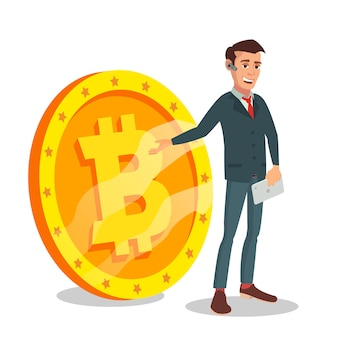 Segno di standing with big bitcoin dell'uomo d'affari