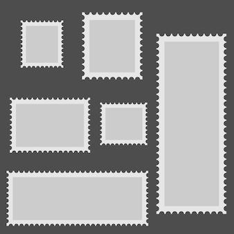 Sei cornici grigie per le foto sono raffigurate su uno sfondo grigio in ordine caotico.