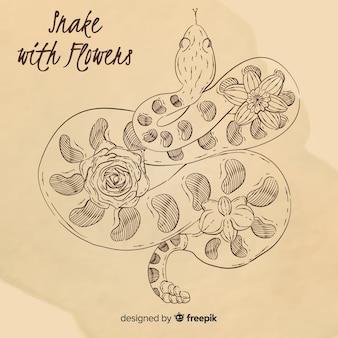 Serpente vintage disegnato a mano con sfondo di fiori