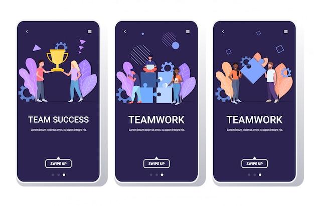 Set businesspeople brainstorming processo holding trofeo d'oro tazza successo lavoro di squadra concetto uomini donne colleghe squadra telefono schermi raccolta mobile app copia spazio orizzontale lunghezza intera