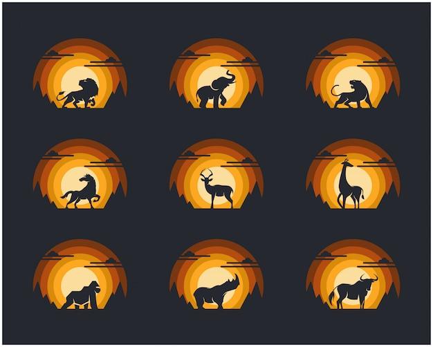 Set di animali con sfondo di montagna e cielo scogliera.