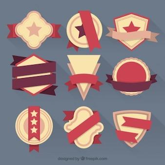 Set di badge d'epoca piane e nastri