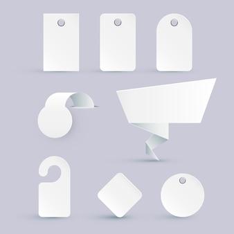 Set di cartellini dei prezzi bianchi di diverse forme con elementi di design. illustrazione