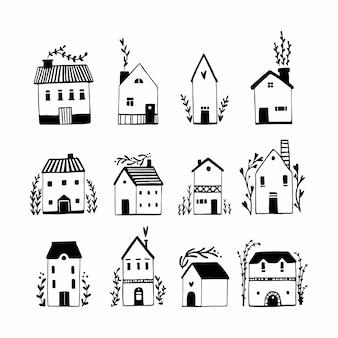 Set di case scandinave. illustrazione disegnata a mano di edifici in un semplice stile cartoon infantile. disegno di schizzo in bianco e nero isolato sveglio