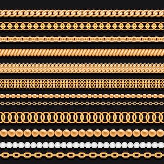 Set di catene d'oro perline e corde su fondo nero