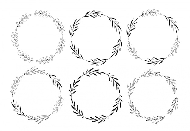 Set di corone floreali rotondi di vettore disegnato a mano