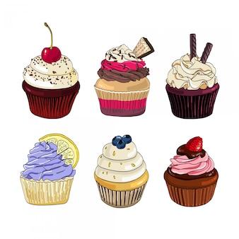 Set di cupcakes su uno sfondo bianco.