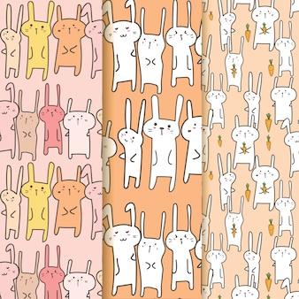 Set di cute bunny pattern background.