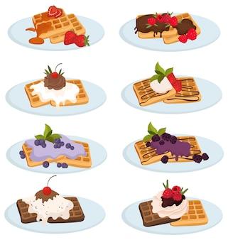 Set di deliziosi waffle belgi. raccolta di cialde su un piatto versato con salsa alle bacche.