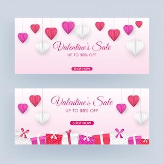 Set di design per intestazione o banner di vendita di san valentino con offerta scontata del 50%, carta origami appesa a cuori e scatole regalo decorate su sfondo rosa.