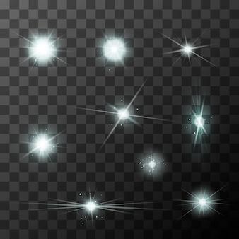 Set di diversi lampi di stelle con scintillii bianchi