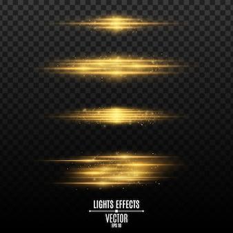 Set di effetti di luce dorata su uno sfondo trasparente.