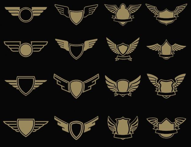 Set di emblemi alati in stile dorato. elementi per, etichetta, emblema, segno. illustrazione.