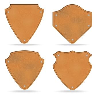 Set di etichette in pelle tag su bianco