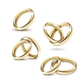 Set di fedi nuziali oro su sfondo bianco