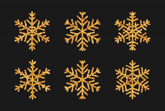 Set di fiocchi di neve con effetto glitter oro. icona neve decorazioni natalizie brilla bagliore dorato.