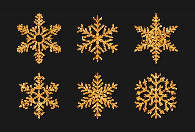 Set di fiocchi di neve con effetto glitter oro. la decorazione natalizia scintilla bagliore dorato.