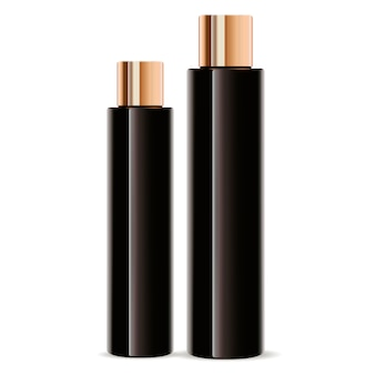 Set di flaconi per la cosmetica in vetro ambrato scuro. cilindro