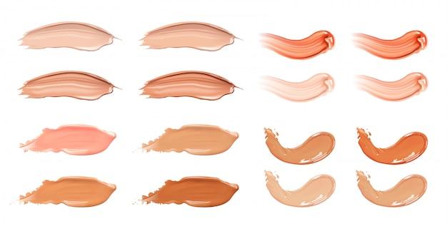 Set di fondotinta liquido cosmetico o pennellate di sbavature di crema al caramello.