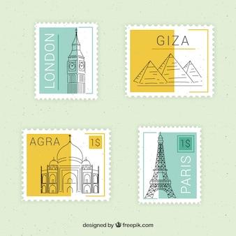 Set di francobolli punto di riferimento con diverse città in stile piano