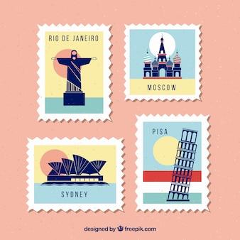 Set di francobolli punto di riferimento con diverse città in stile vintage