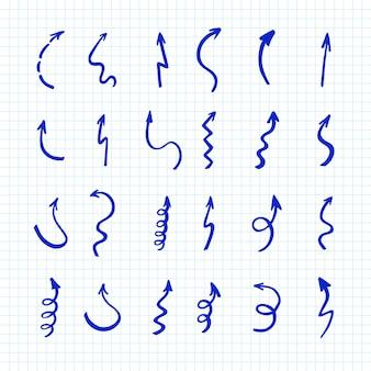 Set di frecce penr su carta controllata. frecce e puntatori di doodle disegnato a mano