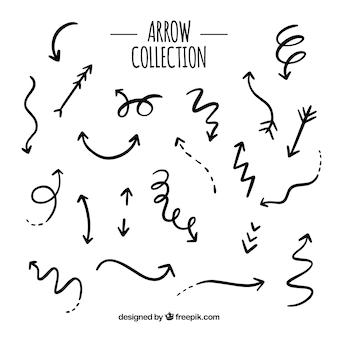 Set di frecce per segnare in mano disegnato stile
