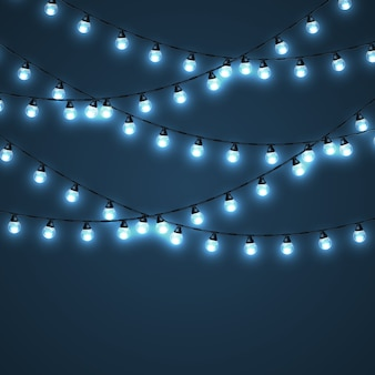 Set di ghirlande luminose su un blu scuro. ghirlanda leggera