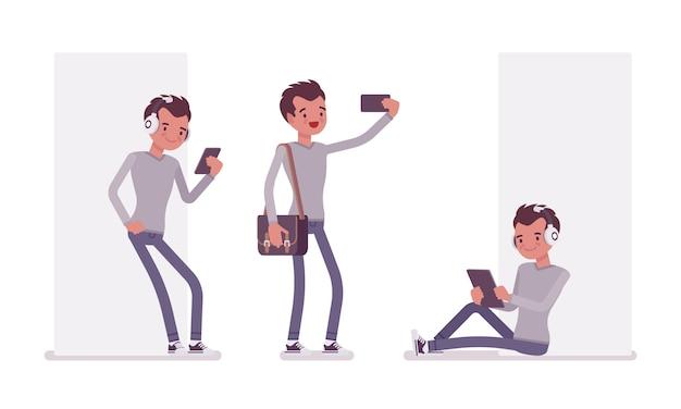 Set di giovane uomo bello con gadget