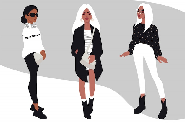 Set di giovani donne. ragazze alla moda in vestiti d'avanguardia isolati su bianco.