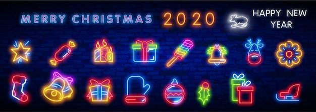 Set di icone al neon di natale. buon natale e felice anno nuovo.